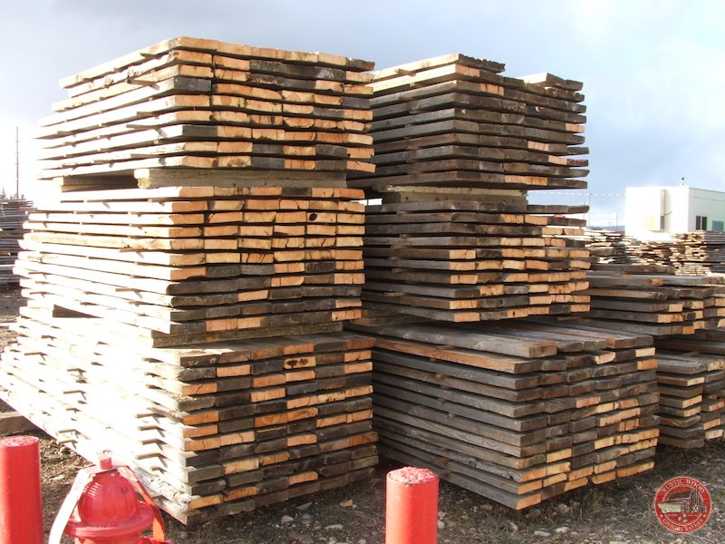 stacks of Rustic Wood Hub's reclaimed corral board